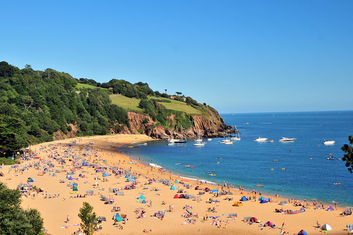 A hot summer and a low pound could be encouraging holiday makers to stay in the UK this summer